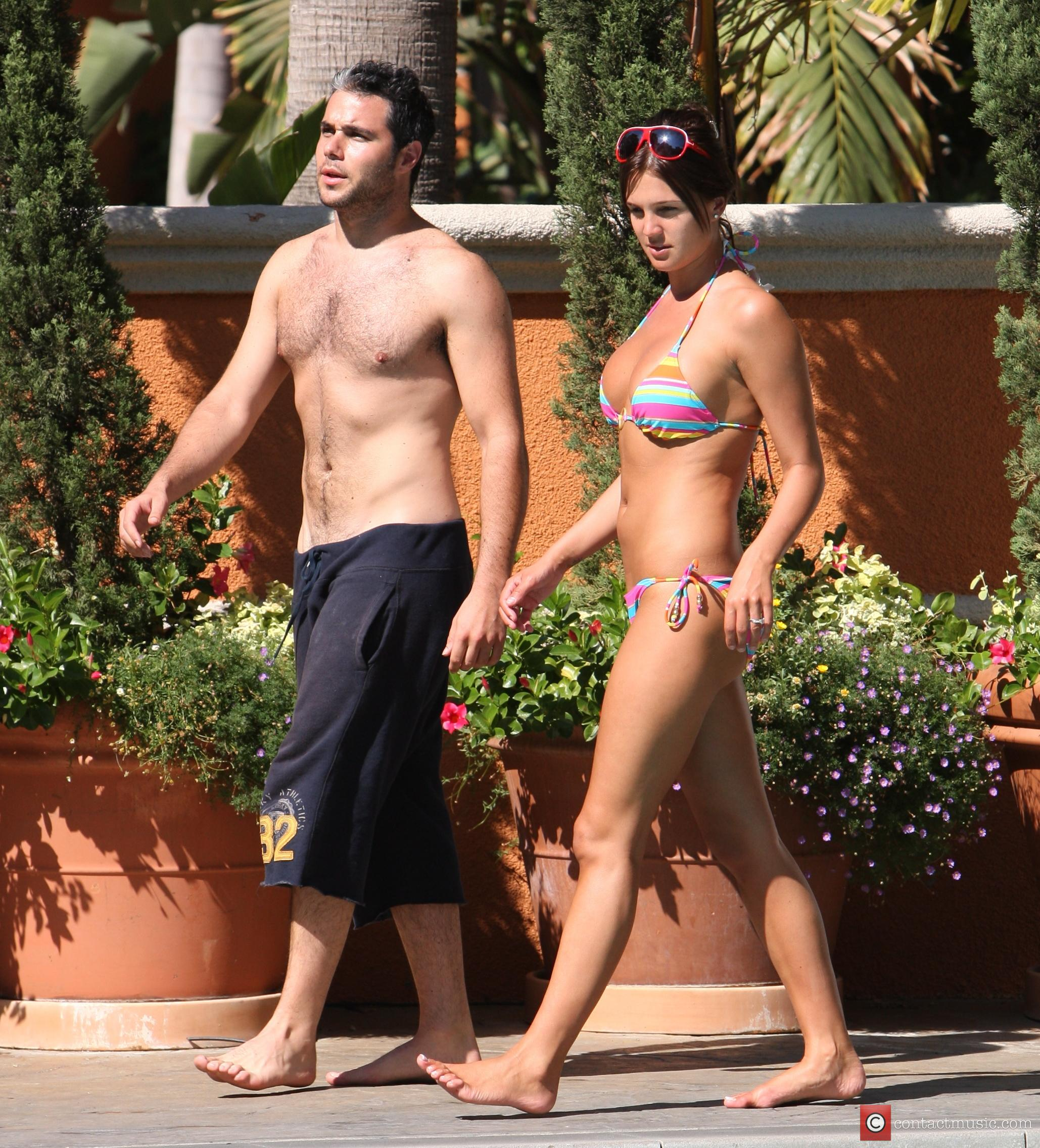 Danielle Lloyd and her friend Owen Beiny sunbath by a hotel pool 14