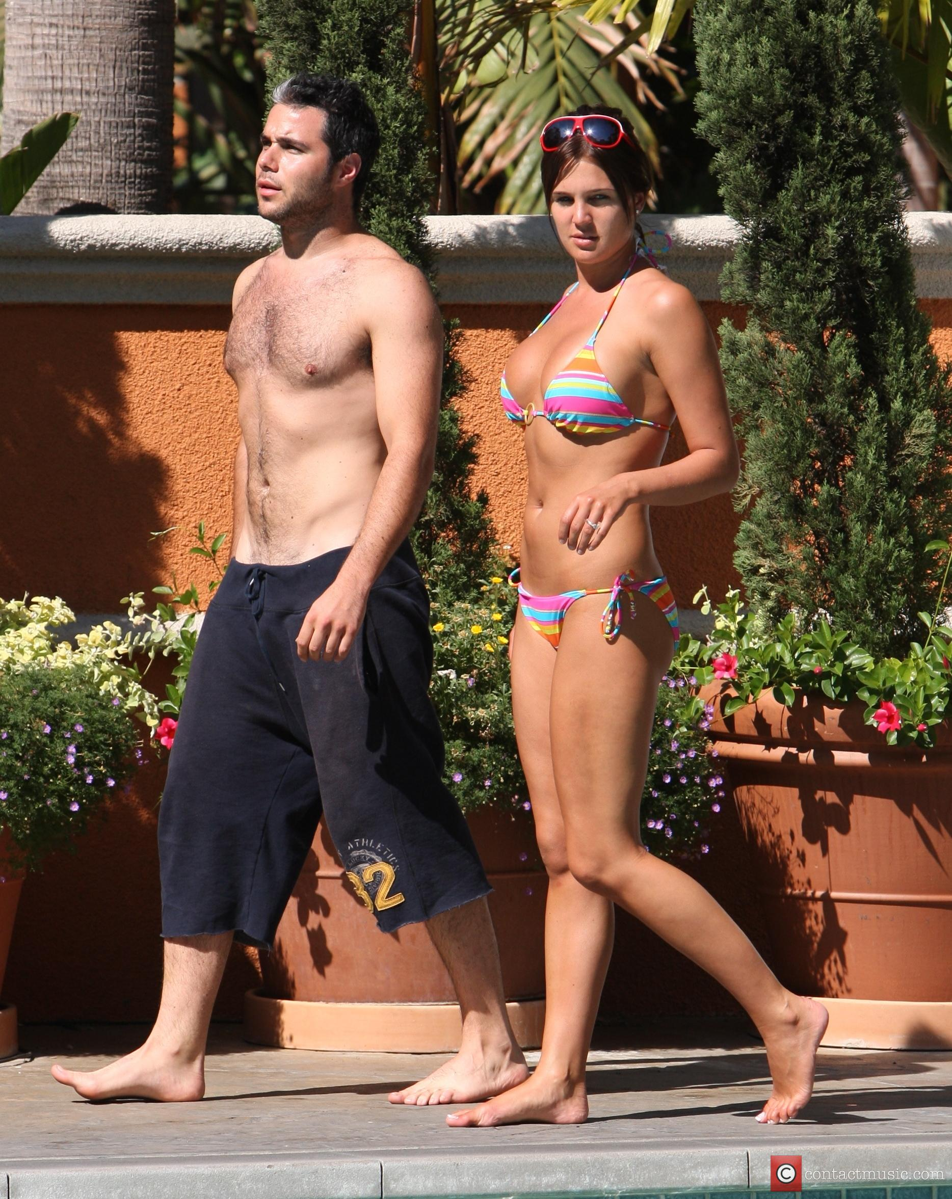 Danielle Lloyd and her friend Owen Beiny sunbath by a hotel pool 9