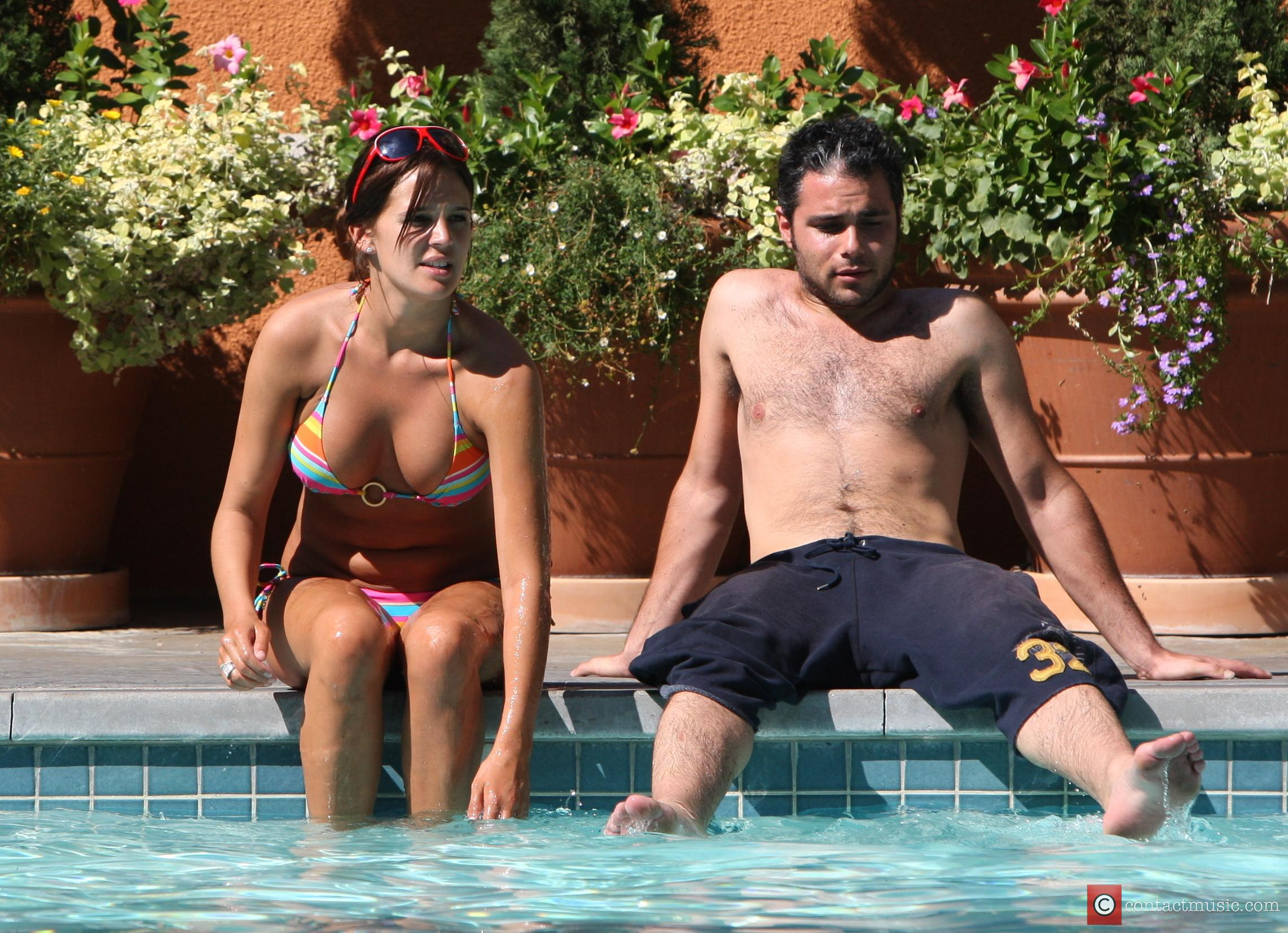 Danielle Lloyd and her friend Owen Beiny sunbath by a hotel pool 11
