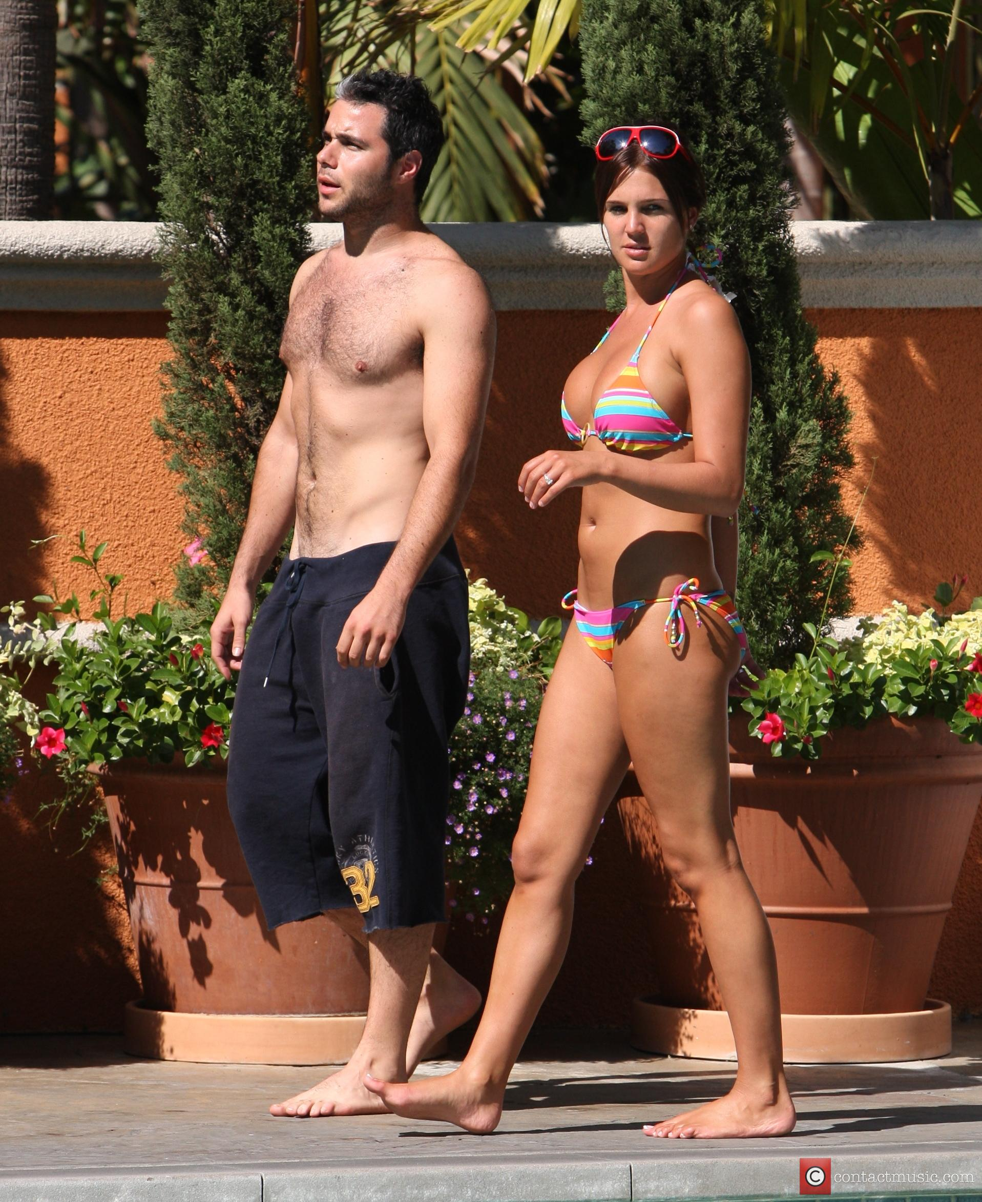 Danielle Lloyd and her friend Owen Beiny sunbath by a hotel pool 12