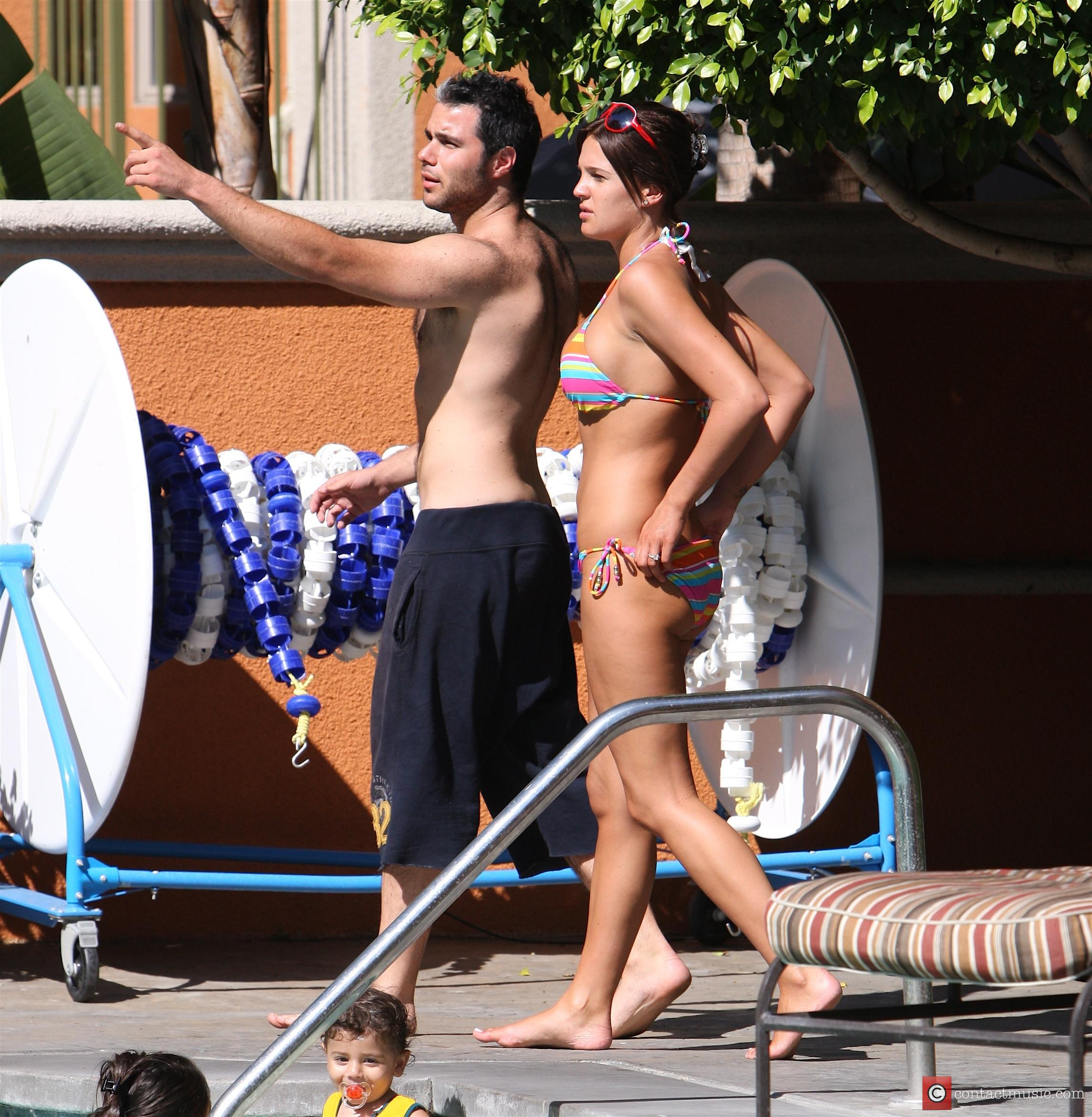 Danielle Lloyd and her friend Owen Beiny sunbath by a hotel pool 10