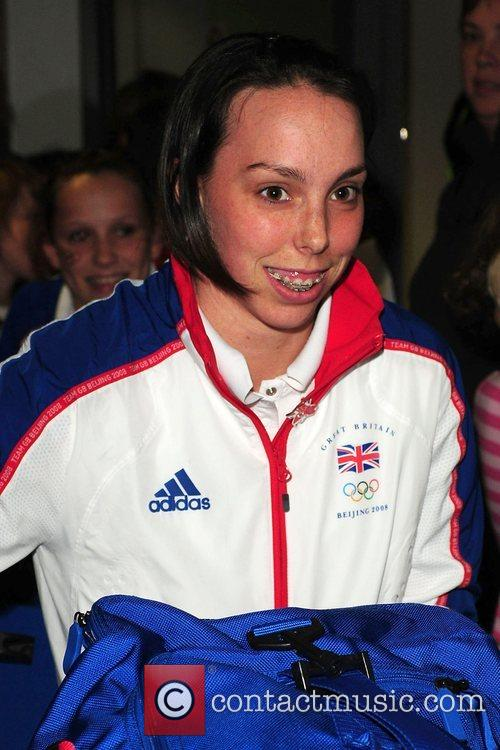 Beth Tweddle arrives at Manchester airport greeted by...