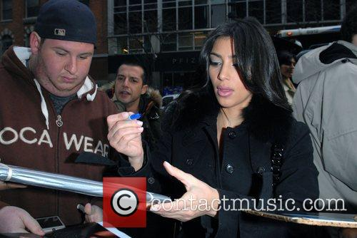 Signing autographs when arriving at the CW11 studios...