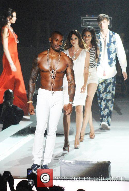 Tyson Beckford walks the catwalk during the fashion...