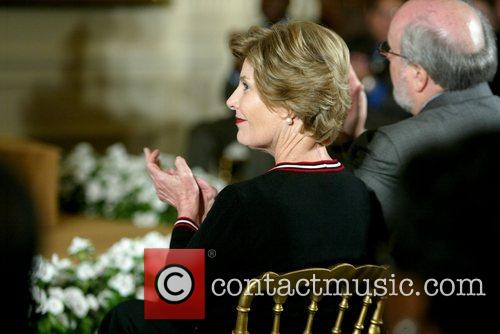 Laura Bush The signing of HR 5501, the...