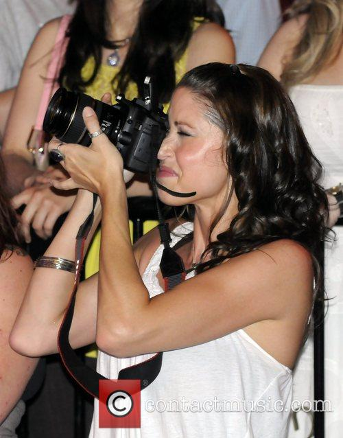 Actress Shannon Elizabeth photographing the band Almost Amy...