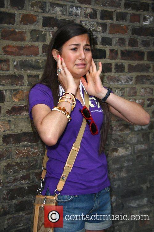 A young female fan, breaks down in tears...