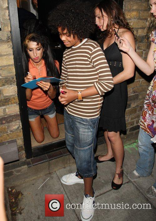 Amy Winehouse delights fans by appearing at her...