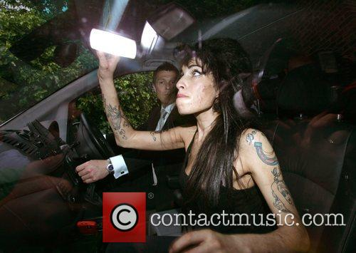 Amy Winehouse arrives at Pentonville Prison to visit...