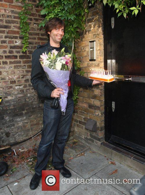 Flowers and a birthday cake are delivered to...