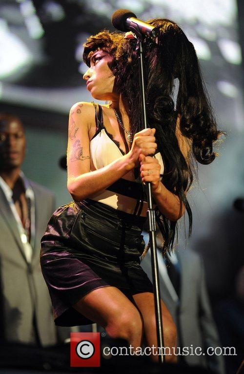 Amy Winehouse and Nelson Mandela 30