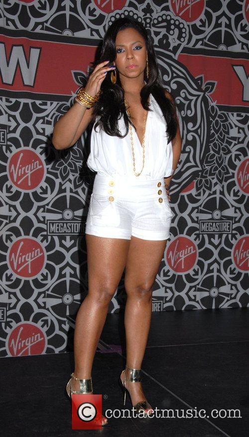 Ashanti gives a live performance and signs copies...