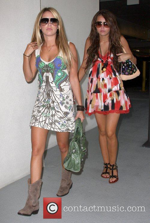 Ashley Tisdale and Miley Cyrus go shopping after...