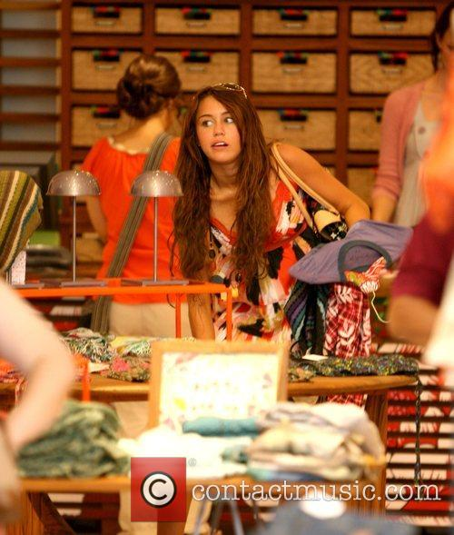 Miley Cyrus does some shopping after eating at...