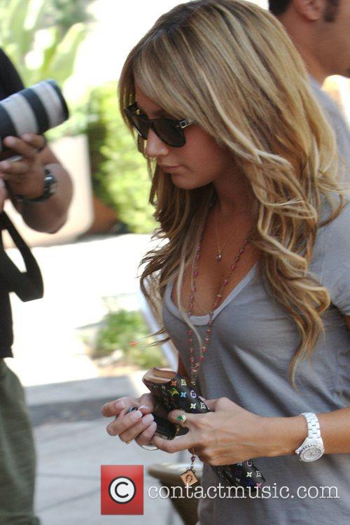 Ashley Tisdale picks up a coffee at The...