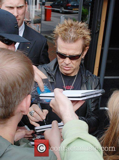 Billy Idol  is mobbed by fans outside...