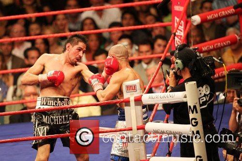 By technical KO in the 11th round at...