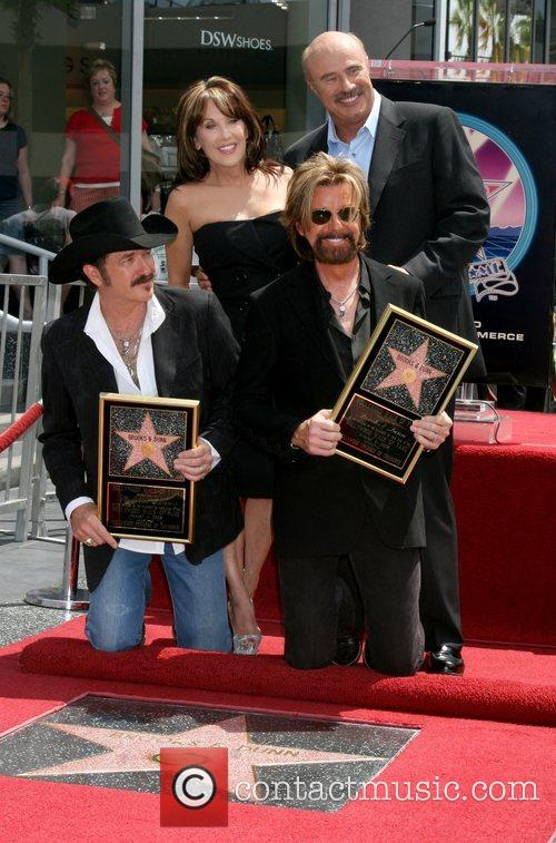 Kix Brooks and Ronnie Dunn, with Dr. Phil...
