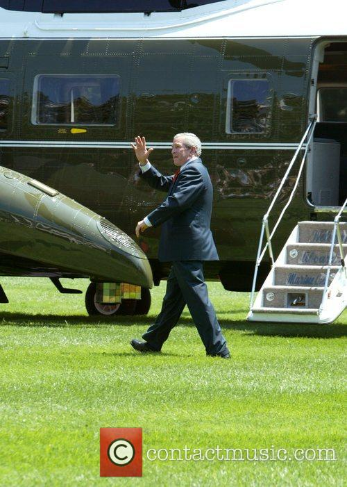 The President departs the Oval Office on Marine...