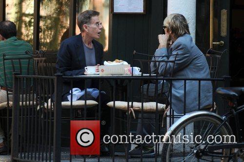 Calvin Klein and a friend enjoy a meal...