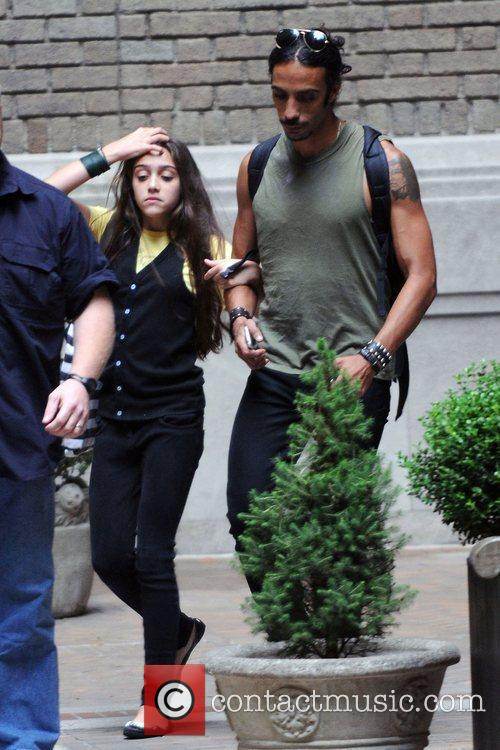 Carlos Leon and daughter Lourdes Leon hail a...