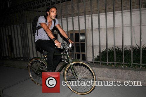 Carlos Leon riding his bike, leaving Madonna's apartment...