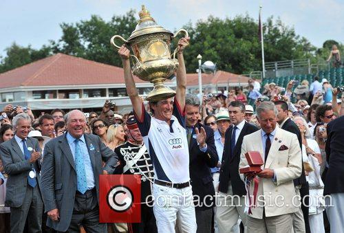 England captain Luke Tomlinson lifts the trophy Cartier...