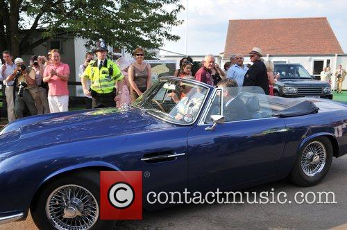 Prince Charles drives away in his wine powered...
