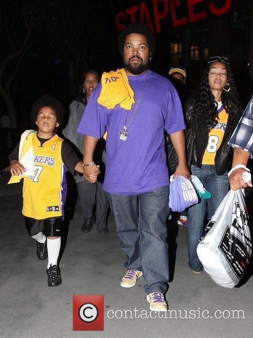Ice Cube with his wife Kimberly Woodruff and...