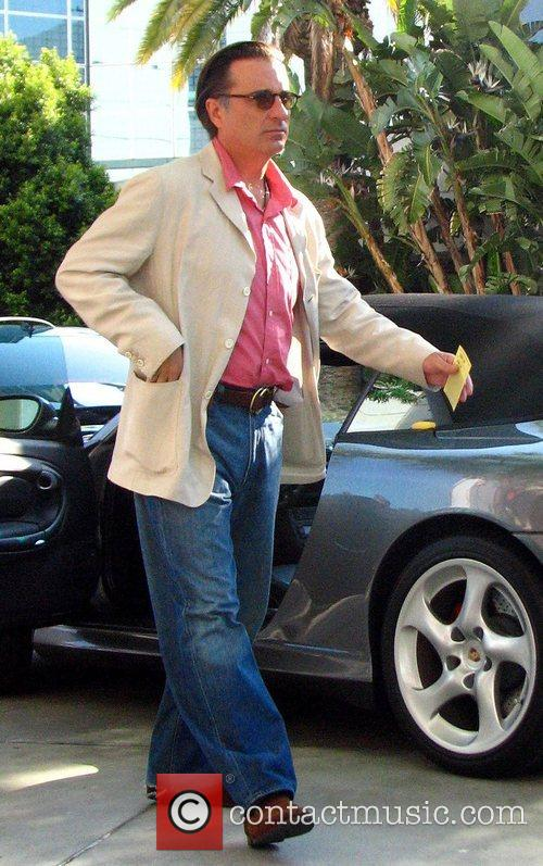 Andy Garcia getting out of his car outside...