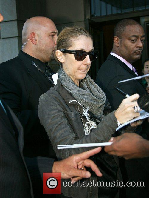 Signs autographs for fans after leaving her Manhattan...