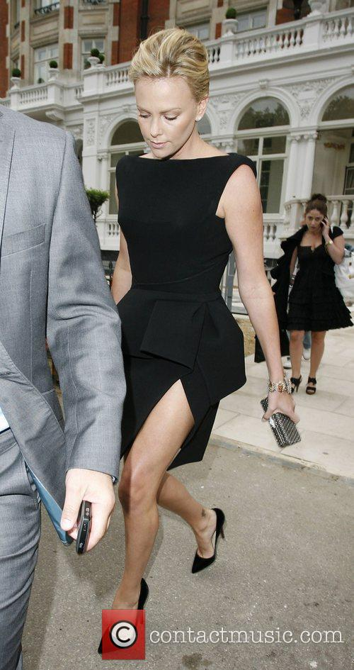 Charlize Theron Leaving her hotel to go to...