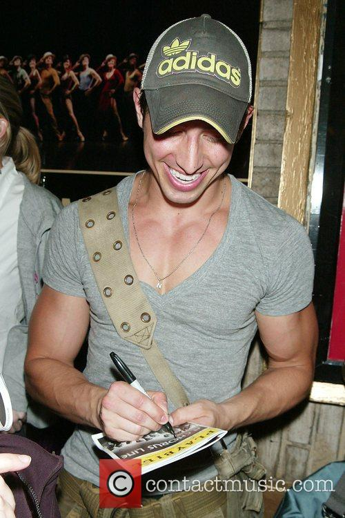 Signs autographs after performing in the Broadway musical...