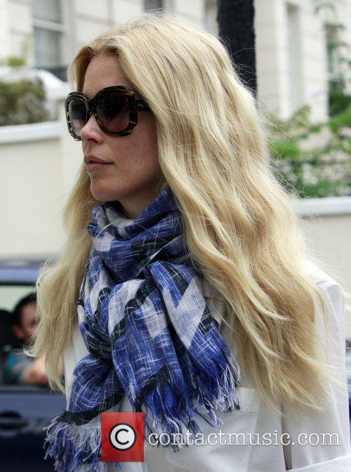Claudia Schiffer looking fresh dressed all in white...