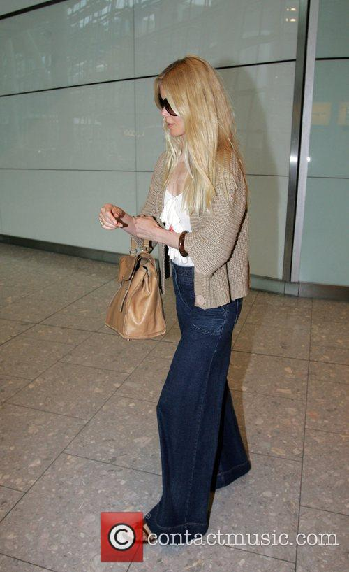 Claudia Schiffer arriving at Heathrow Airport after flying...