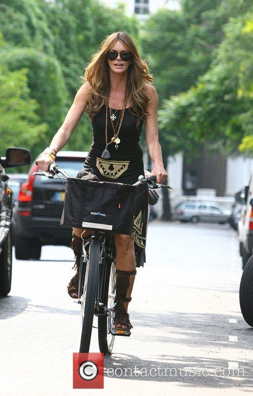 Elle Macpherson arrives on her bicycle to pick...