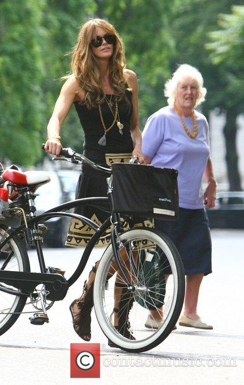 Arrives on her bicycle to pick up her...
