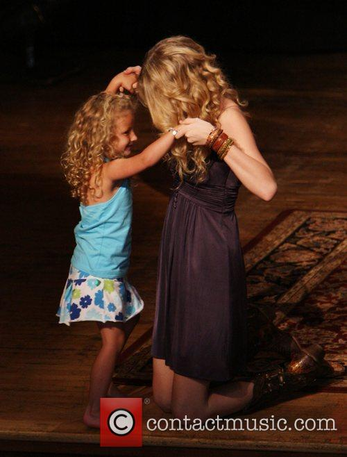 Taylor Swift and a young fan 8