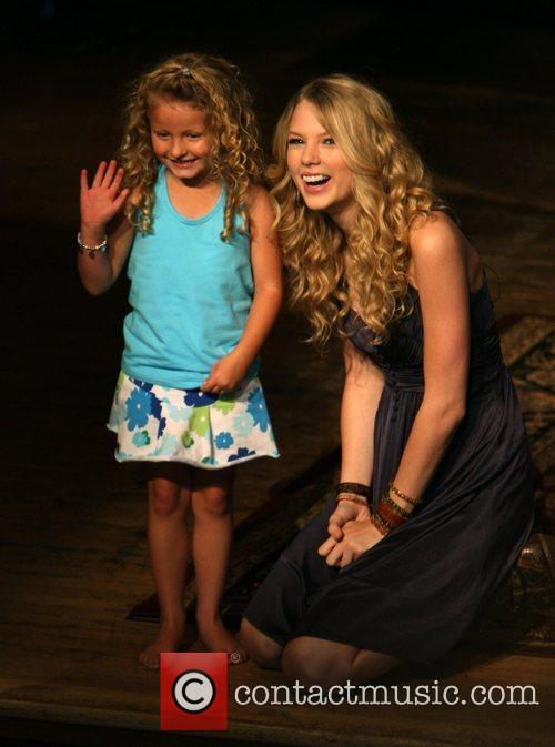 Taylor Swift and a young fan 11
