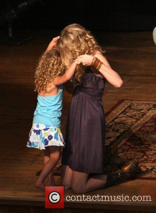 Taylor Swift and a young fan 5