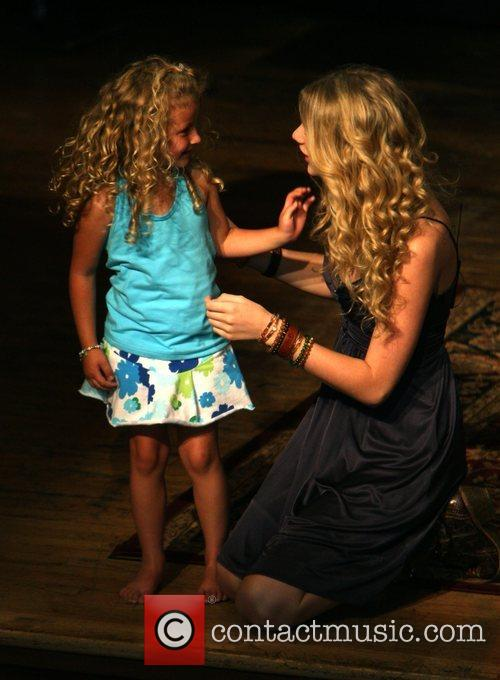 Taylor Swift and a young fan 6