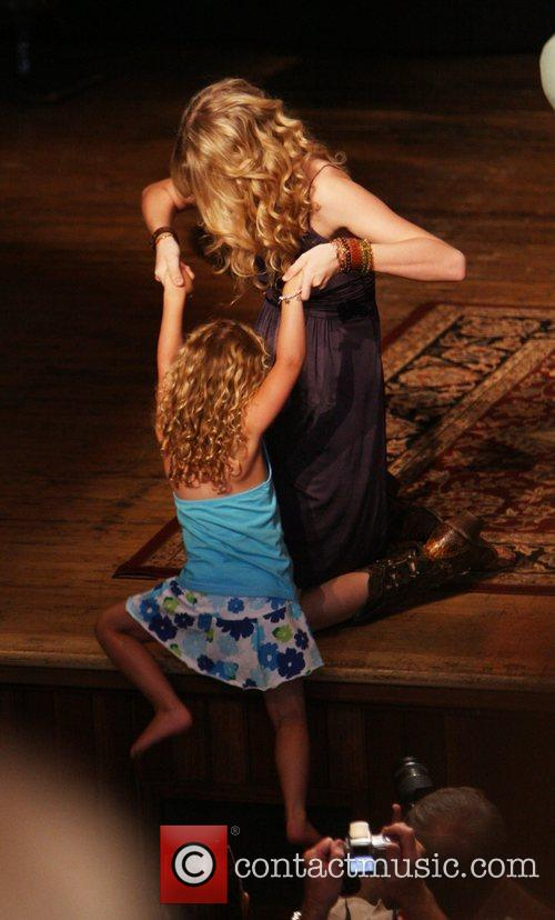 Taylor Swift and a young fan 7