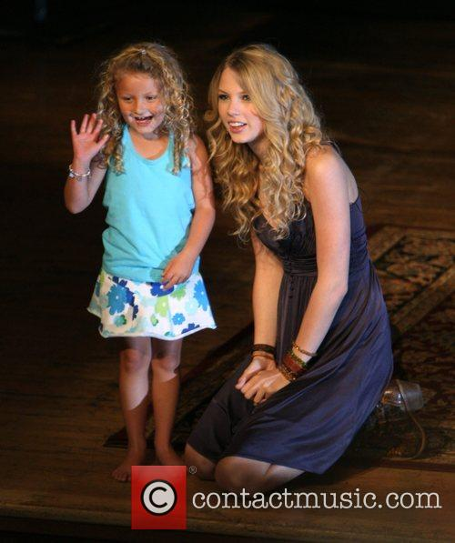 Taylor Swift and a young fan 4