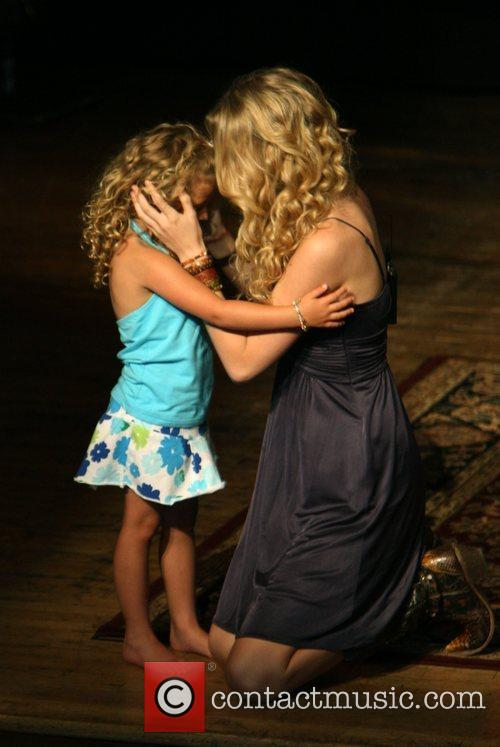 Taylor Swift and a young fan 9