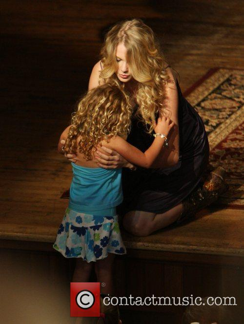 Taylor Swift and a young fan 12