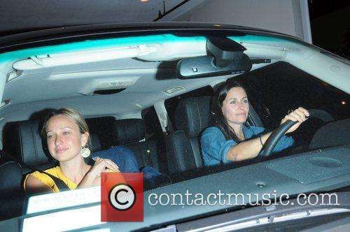 Jennifer Meyer and Courteney Cox leaving a parking garage...