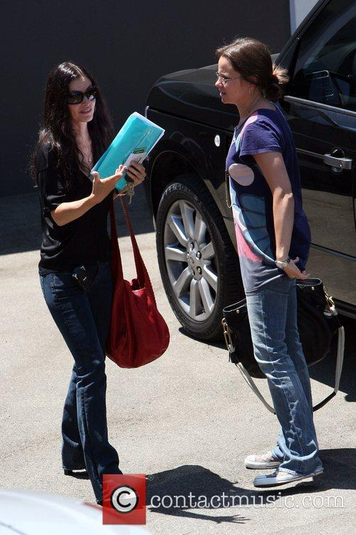 Courteney Cox  picking up her kid from...