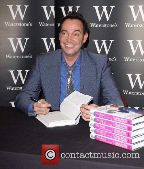 Signing his book 'All Balls and Glitter' at...