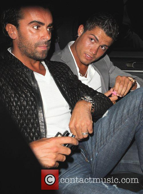 Leaving STK restaurant on crutches. Ronaldo recently underwent...