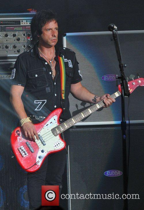Bass Guitarist Jimmy Ashurst of Buckcherry performing on...
